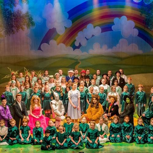Children dressed as Wizard of Oz characters on a stage.